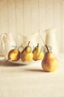 Fresh pears on old wooden table with vintage feeling