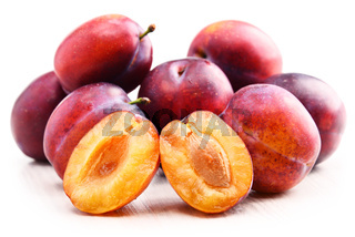 Composition with plums isolated on white background.