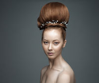 Beauty Girl Portrait. High hairstyle with decorations, fashion portrait.