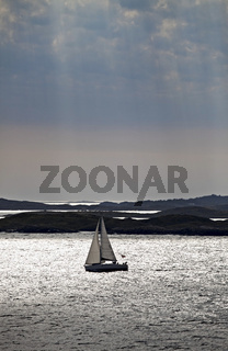 silhouette of a sail boat late in the afternoon