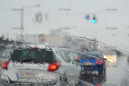 Rainy weather on the road with vehicles