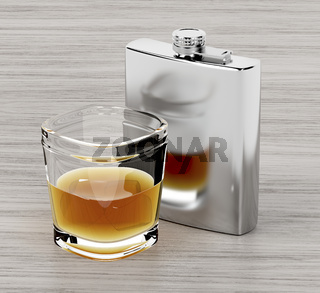Hip flask and a glass of brandy