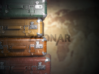 Vintage suitcases on the map background.Turism travel concept.