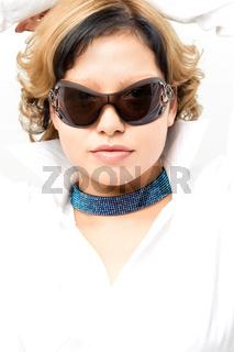 portrait of young beautiful woman wearing sunglasses