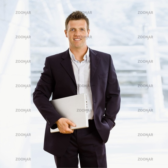 Happy businessman indoor