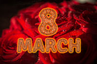 8 March symbol. Figure eight made gold flying in the air over rose flower background. Can be used as a decorative greeting or postcard for international Woman's Day 3d illustration
