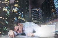 Exhausted businessman sleeps