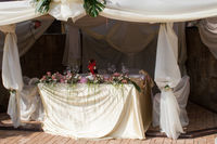 wedding dinner decorated with flowers and a silk bow