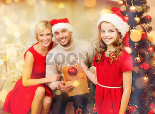 smiling family decorating christmas tree