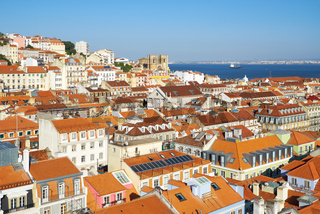 The residential houses of Alfama with Tejo river on the background. Lisbon. Portugal