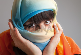 Girl in colorful headscarf