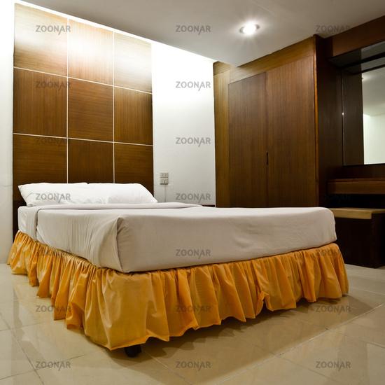 Hotel bedroom interior in evening