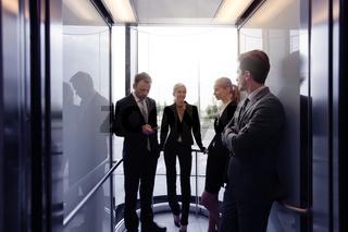 Business team on elevator