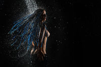 Blue dreadlocks topless woman rearview in shower