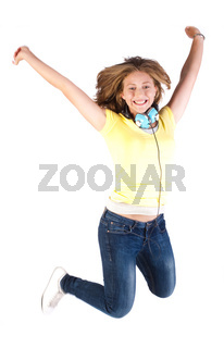 Girl jumping high with headphones around her neck