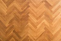wooden floor background - herringbone parquet background