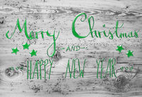Green Calligraphy Merry Christmas And Happy New Year, Wooden Background