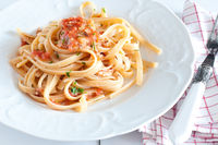 noodles with crab sauce and chopped tomatoes