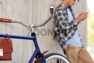 man with fixed gear bicycle on street