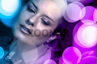 Beautiful woman with disco lights
