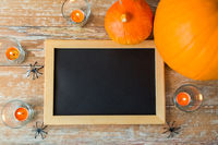 blank chalkboard and halloween decorations