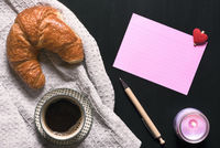 Blank paper note and coffee with croissant
