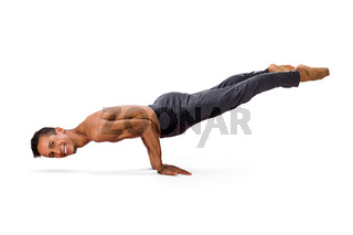 Man practicing youga peacock pose mayurasana