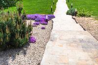 path through alpine garden and sloped lawn