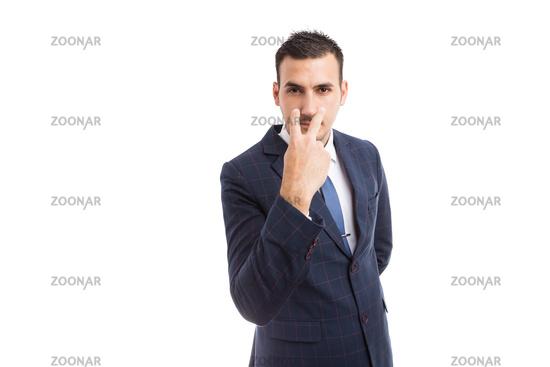 Broker banker or entrepreneur making pay attention gesture