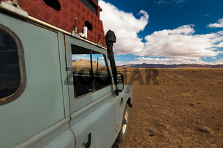 Offroad vehicle oldtimer driving off road in Morocco