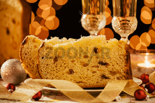 Closeup of sliced italian panettone and sparkling wine