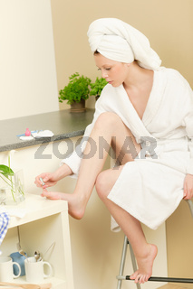 Young student girl polishing her toe nails