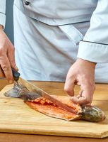Cook cuts fish full collection of food recipes