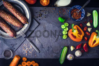 Kebabs with seasoning and vegetable. Concept Middle east , Asian and Caucasian cuisine