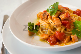 Spaghetti with fish and little tomatoes