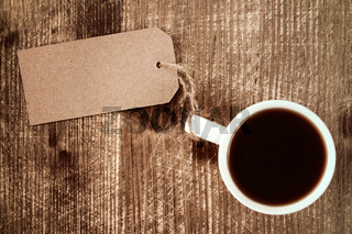Coffee cup with paper blank tag.