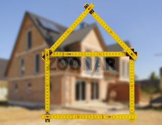 Hausbau und Verkauf mit Meterstab