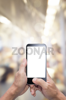 Hands holding and using smartphone blank screen on blur background