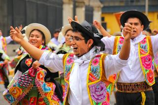 Local men dancing during Festival of the Virgin de la Candelaria in Lima, Peru