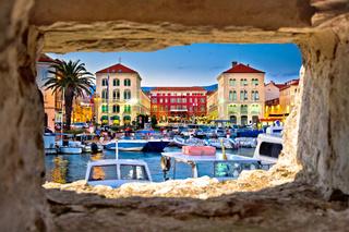 Prokurative square in Split through stone window