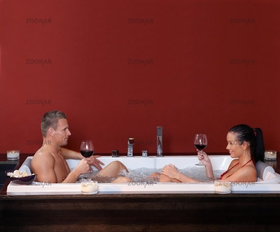 Happy couple in jacuzzi