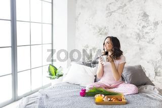 Young pretty woman having breakfast