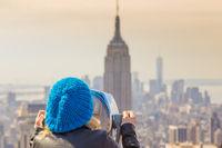 Woman enjoying in New York City panoramic view.