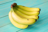 Bananas on blue painted wooden background