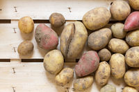Organic potatoes in a wooden box
