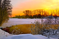 Sunset on winter river