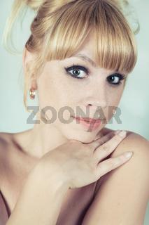 Studio portrait of a beautiful blonde girl close-up