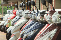 Goa, India - March 05, 2015: Scooters parked on a city street