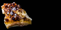 Stone with many crystals of quartz (smoke-quartz), isolated in front of black background with free s