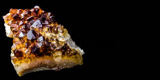 Stone with many crystals of quartz (smoke-quartz), isolated in front of black background with free space